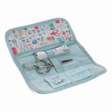 "Load image into Gallery viewer, Travel Sewing Kit in ""stitch in time"" fabric roll case. Scissors, tape measure, needles."