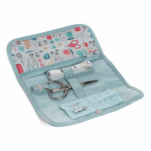 "Travel Sewing Kit in ""stitch in time"" fabric roll case. Scissors, tape measure, needles."
