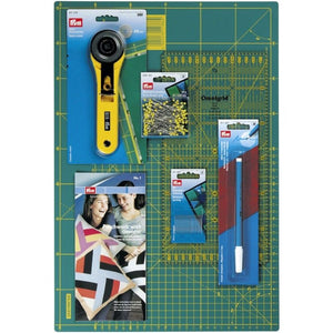 Prym Patchwork and Quilting Starter Set: Rotary cutter, mat, pins, needles, fabric pen.