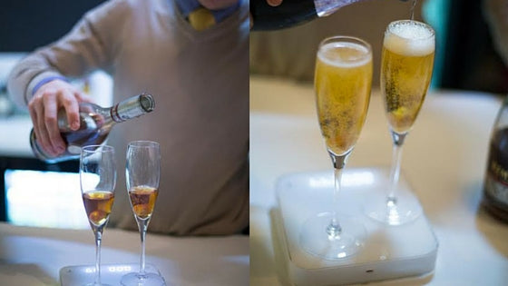 champagne being poured on scale in bar