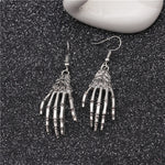Load image into Gallery viewer, Halloween skull palm earrings