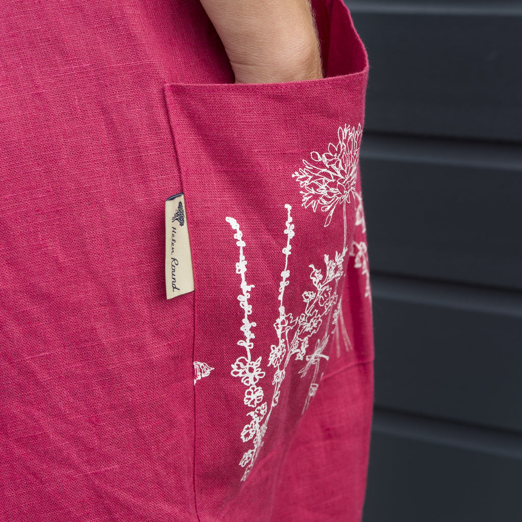 red linen apron pocket printed with flowers