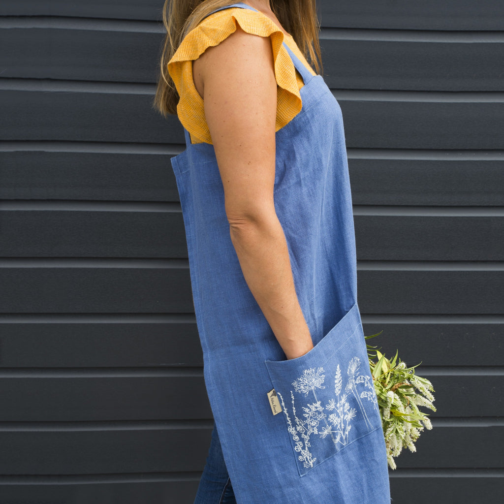 long blue linen apron printed pocket flowers