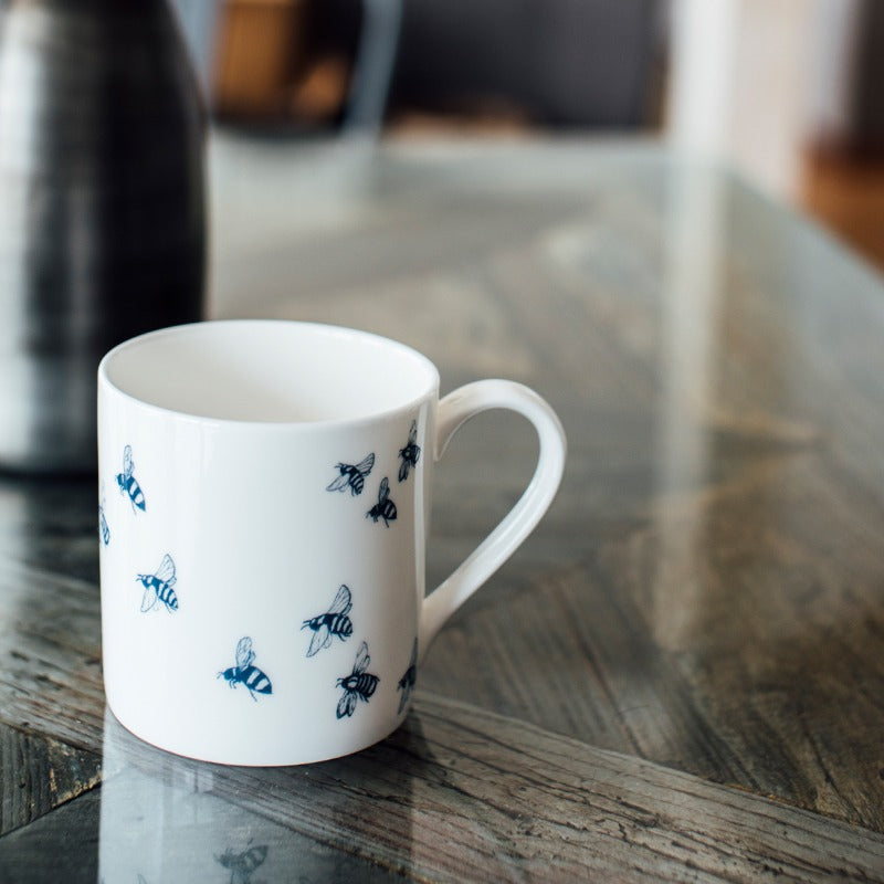 white bee mug with blue bees