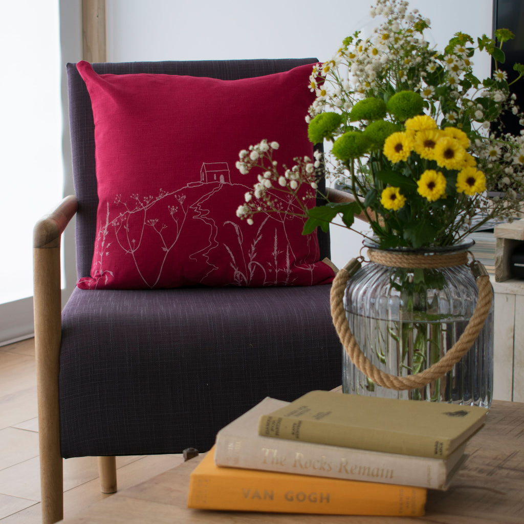 rame head cushion raspberry linen