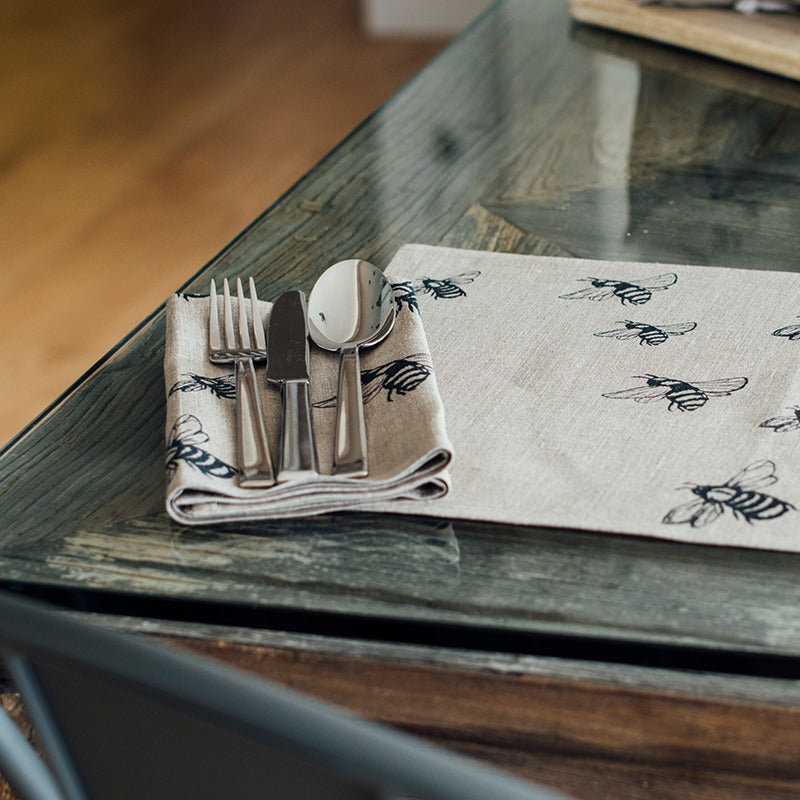 bee napkins in natural linen with bee design