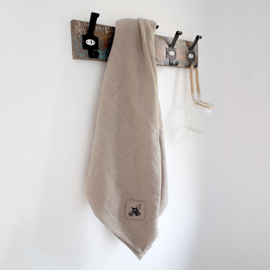honey bee linen throw in natural linen hanging up draped throw