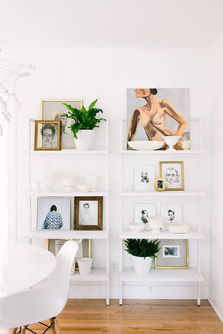 bookshelf styling with artwork laura of pembroke