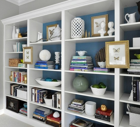 bookshelf styling with wallpaper or paint