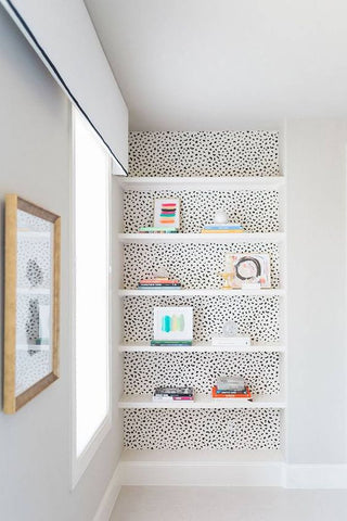 bookshelf styling with wallpaper or paint laura of pembroke