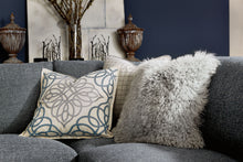 Sectional with Embroidered and Mongolian Fur Pillows