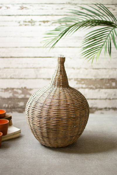 wicker vessel with glass neck