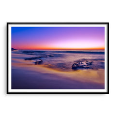 A purple sunset at North Cottesloe Beach in Western Australia framed in black
