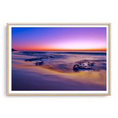 A purple sunset at North Cottesloe Beach in Western Australia framed in raw oak