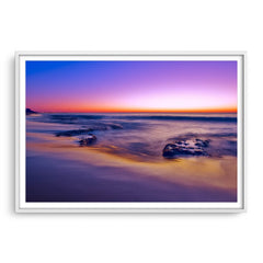 A purple sunset at North Cottesloe Beach in Western Australia framed in white