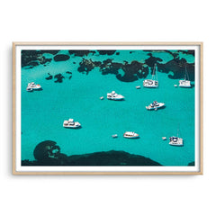Aerial view of boats at Rottnest Island in Western Australia framed in raw oak