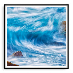 Blue wave in slow motion framed in black