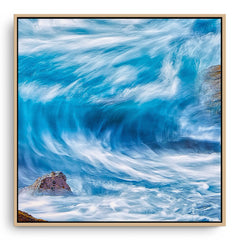 Blue wave in slow motion framed canvas in raw oak