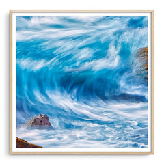 Blue wave in slow motion framed in raw oak
