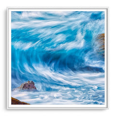 Blue wave in slow motion framed in white