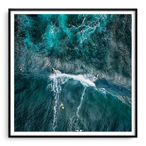 Aerial view of two surfers at Margaret River Main Break in Western Australia framed in black