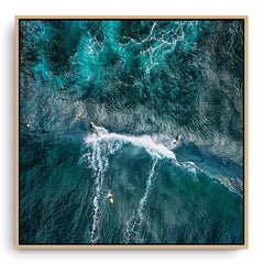 Aerial view of two surfers at Margaret River Main Break in Western Australia framed canvas in raw oak