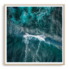Aerial view of two surfers at Margaret River Main Break in Western Australia framed in raw oak
