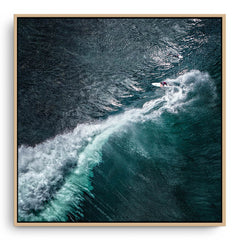Aerial view of surfer at Margaret River Main Break in Western Australia framed canvas in raw oak