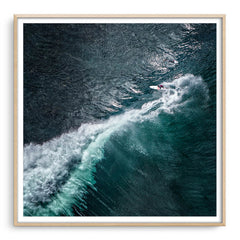 Aerial view of surfer at Margaret River Main Break in Western Australia framed in raw oak