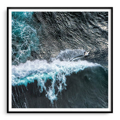 Aerial view of surfer at Margaret River Main Break in Western Australia framed in black