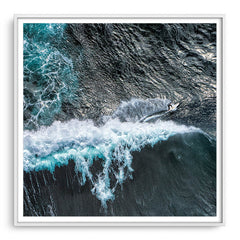 Aerial view of surfer at Margaret River Main Break in Western Australia framed in white