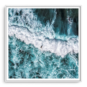 Aerial view of surfers at Margaret River Main Break in Western Australia framed in white