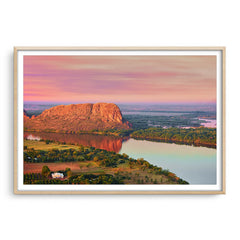 Elephant rock at sunset on Lake Kununurra in Western Australia framed in raw oak