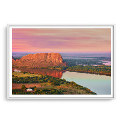 Elephant rock at sunset on Lake Kununurra in Western Australia framed in white