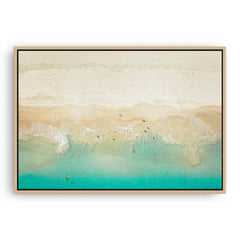Aerial view of dogs playing in the ocean, Perth, Western Australia framed canvas in raw oak