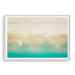 Aerial view of dogs playing in the ocean, Perth, Western Australia framed in white