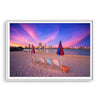 Deckchairs on the beach, overlooking Perth City at sunset in Western Australia framed in white