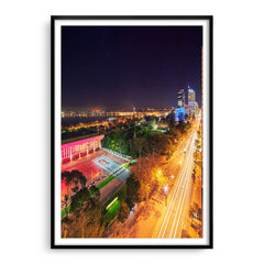 Nighttime down St Georges Terrace in Perth, Western Australia framed in black