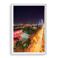 Nighttime down St Georges Terrace in Perth, Western Australia framed in white
