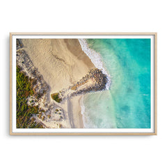 Aerial view of surfers at Sorrento Beach in Western Australia framed in raw oak