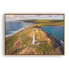 Aerial view of Cape Leeuwin Lighthouse at sunset framed canvas in raw oak
