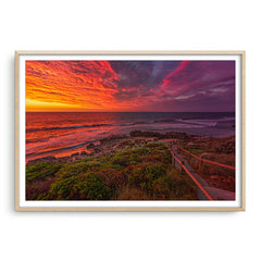 Colourful sunset at Bennion Beach in Perth, Western Australia framed in raw oak