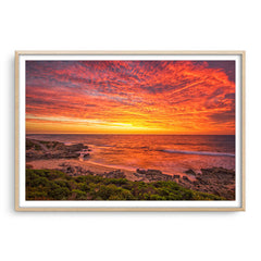 Incredible sunset over Bennion Beach in Perth, Western Australia framed in raw oak