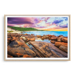 Sunrise over the beaches of Augusta in Western Australia framed in raw oak