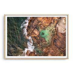 Aerial view of the rock pools at Cape Leeuwin in Western Australia framed in raw oak