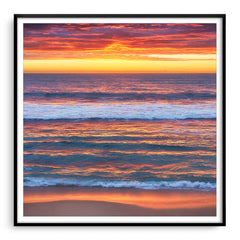 Multi-layered sunset at Mettams Pool in Perth, Western Australia framed in black