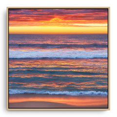 Multi-layered sunset at Mettams Pool in Perth, Western Australia framed canvas in raw oak