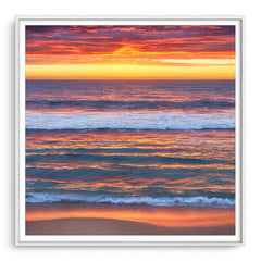 Multi-layered sunset at Mettams Pool in Perth, Western Australia framed in white