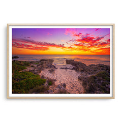 Watching the sunset at Mettams Beach in Western Australia framed in raw oak