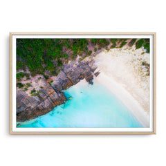 Aerial view of 11 Mile Beach in Esperance, Western Australia framed in raw oak